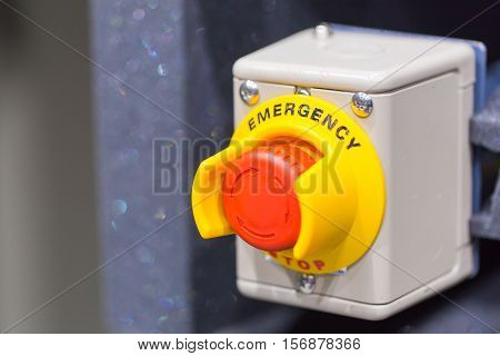 Hand Pressing The Red Emergency Button Or Stop Button. Stop Button For Industrial Machine, Emergeny