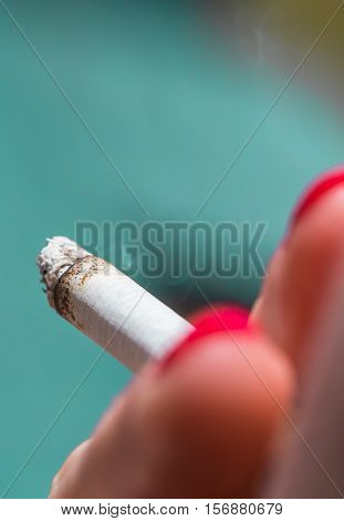 A Woman Holding A Cigarette