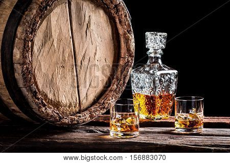 Two Glasses Of Aged Whisky With Ice