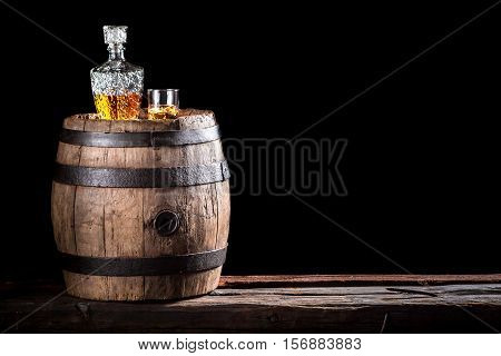 Glass Of Golden Aged Brandy Or Whiskey On The Rocks