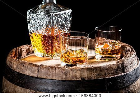 Two Glasses Of Aged Whiskey Or Brandy On The Rocks