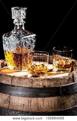 Two Glassed Of Aged Brandy Or Whiskey On The Rocks