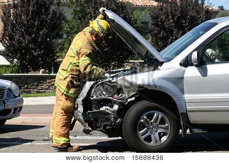 Fireman checking crashed car