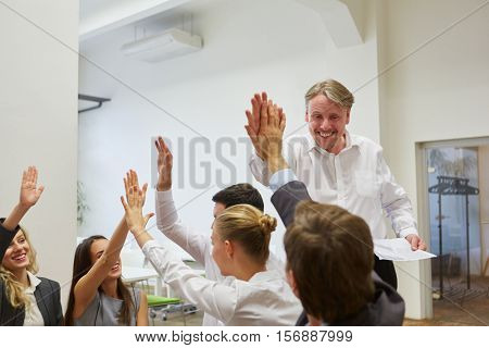 CEO and happy business team celebrate their success with a high five