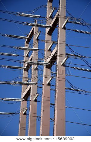 Powerlines against bright blue sky