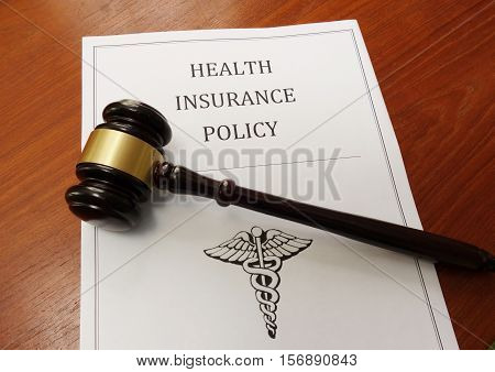 Health insurance policy and judge's legal gavel