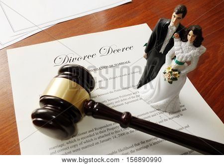 Divorce decree and gavel with bride and groom couple