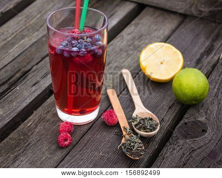 juice smoothie bubble tea with berries and lemon on the background of meadows