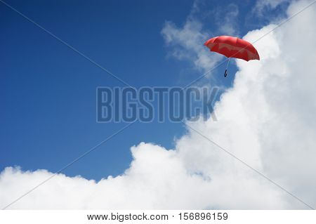 3D Rendering : Illustration Of Red Umbrella Floating Above Against Blue Sky And Clouds. Business, Le