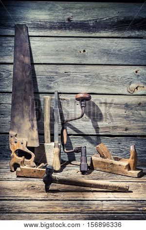 Hammer, Saw And Chisel On Old Wooden Table