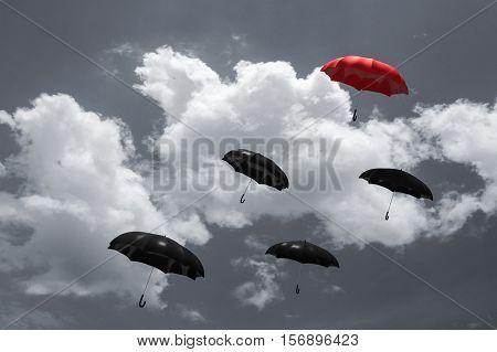 3D Rendering : Illustration Of Red Umbrella Floating Above On Many Black Umbrellas Against Blue Sky