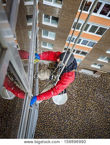 window washer cleans the residential building glass