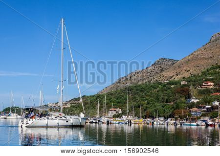 sailing yacht in the port on a background of mountains
