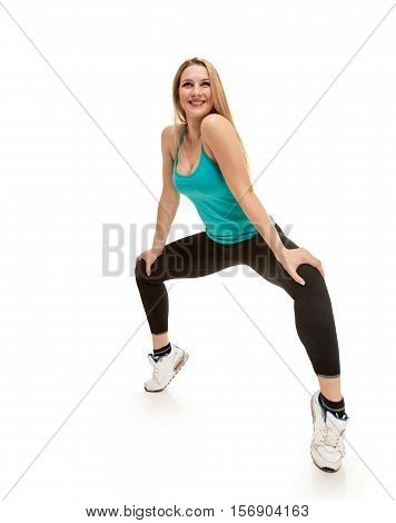 fitness woman. Young sporty Caucasian female model isolated on white background in full body. She is on tiptoes