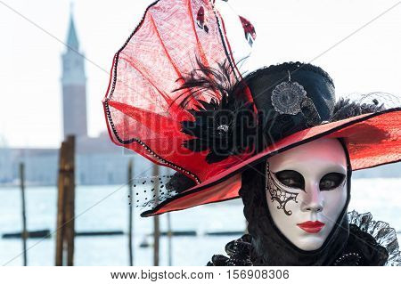 Venetian romantic mask royalty-free stock photo Venice, Italy - February 16, 2015: Portrait of a romantic female mask at the Grand canal