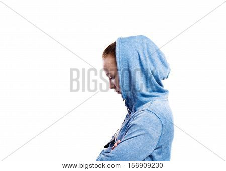 Teenage girl in blue sweatshirt, hood on head. Beautiful young sportswoman, studio shot on white background, isolated. Side view.