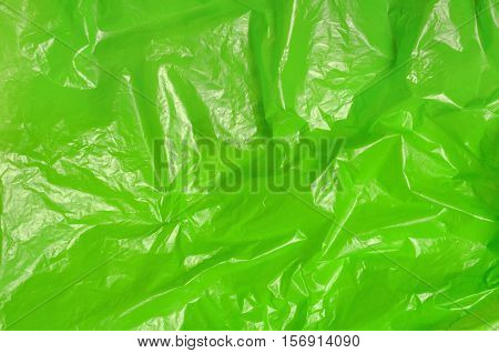 green trash bag plastic texture background photo