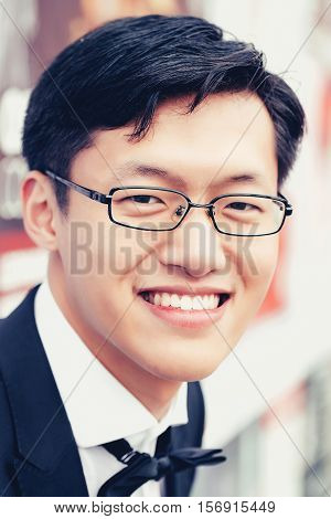 Chinese Man Smiles Outdoors