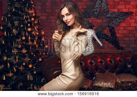 Happy Christmas To My Friends! Girl With A Champagne And High Heels In Her Hands.
