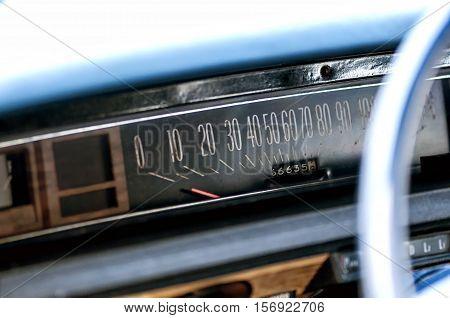 Old vintage car meter with rust. Horizontal speedometer