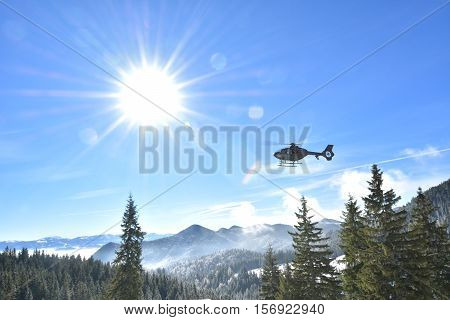 Rescue helicopter in mountains. Piatra Craiului National Park.