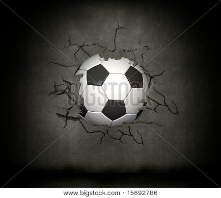 A soccer ball wedged into a concrete wall