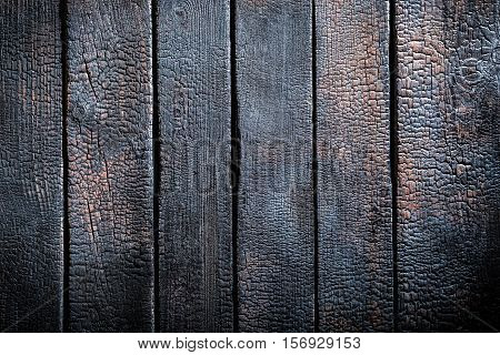 Black Burnt Black Wooden Table As Background