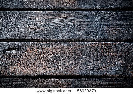 Closeup Of Burnt Wooden Fence As Background