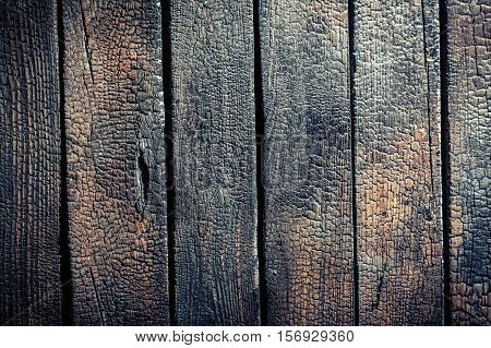 Closeup Of Black Burnt Wooden Fence As Background