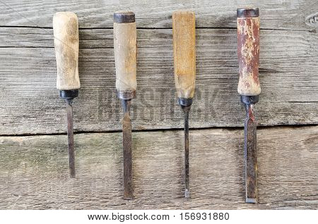 Instrument mortise chisel on wooden board background