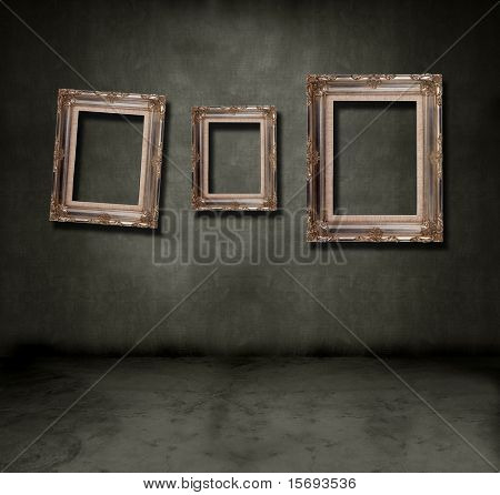 Dark grungy room with antique empty frames