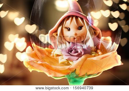 Elf in a Wine Glass with hearths bokeh