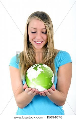 Pretty young woman holding a globe in her hands