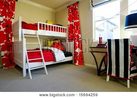 Little girl's bedroom with bright red flower fabric