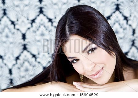 Elegant brunette woman with victorian background
