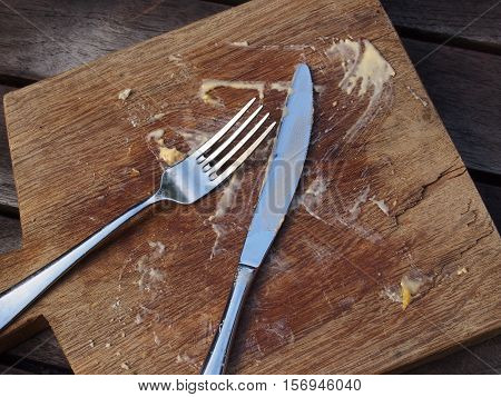 Empty plate with food remnants and dirty utensils