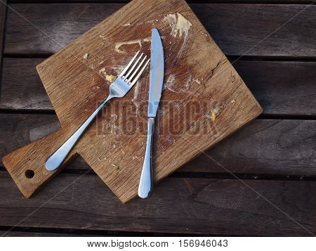 Empty plate seen with food remnants and dirty utensils