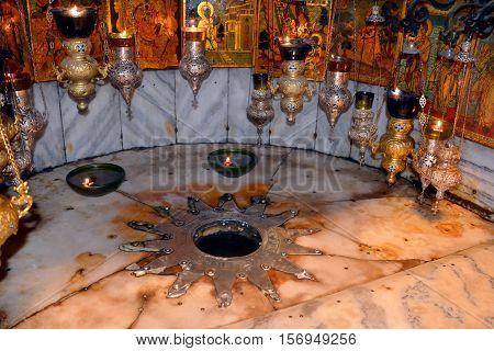 BETHLEHEM ISRAEL 26 10 16: Church of the Nativity grotto Fourteen-point silver star Od David of Bethlehem reputedly marks where Jesus was born