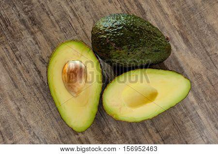 Fresh tropical avocado fruit studio isolated on wood background