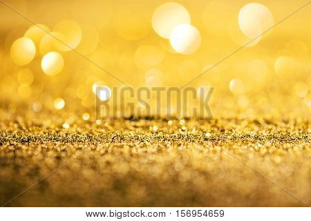 Gold luxury glitter de focused abstract background with copy space