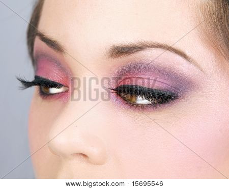 Closeup of a woman's eyes with smoky makeup