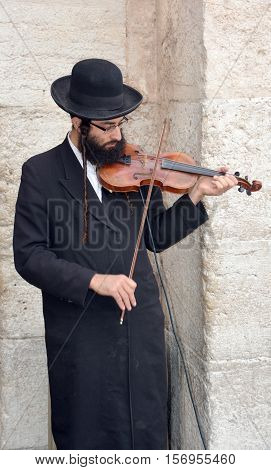 JERUSALEM ISRAEL 26 10 16: Jewish hasidic play violin near the Tower of David Hasidism is religious sect arose as a spiritual movement in contemporary Ukraine during the 18th and spread through Europe