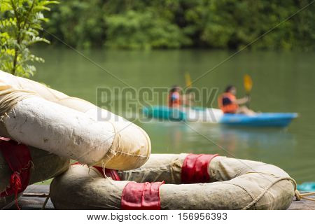 Life ring or life buoy for safety and traveler with canoe in the lake background