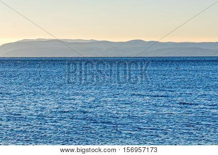Blue sea landscape in front of the Tucepi town beach, view of island Brac coast.