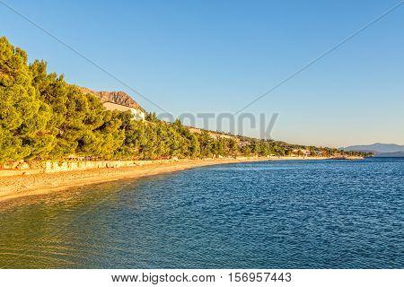 Beautiful sunshine on the Tucepi town long beach.