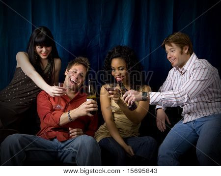 Attractive friends at a club drinking