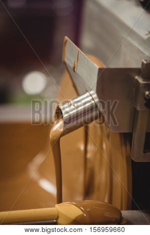 Close-up of chocolate blending machine in kitchen