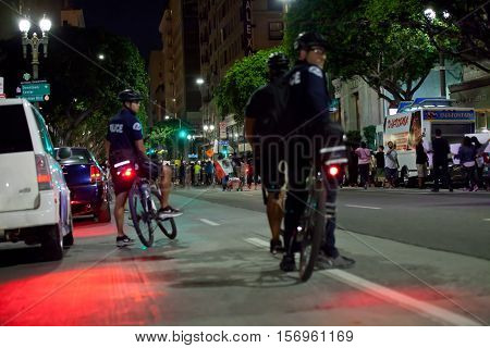 LOS ANGELES, CALIFORNIA - NOVEMBER 11, 2016: LAPD officers on bicycles escorting rally protesters. Second day of the Los Angeles City Hall Rally: Down with Trump! Pt. 2.