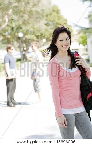 Happy college student  at her university