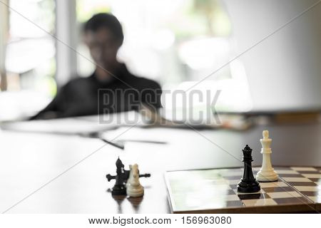 young business men playing chess, planing concept.